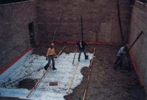 David pouring concrete